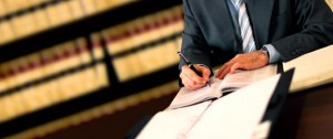 paralegal at desk working in a law office